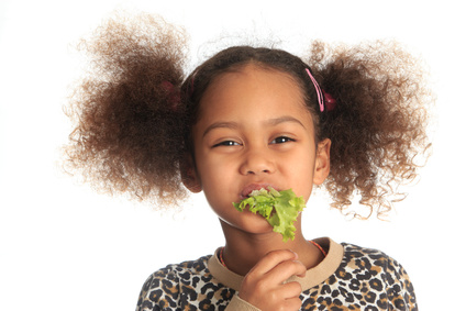 girl eating lettuce