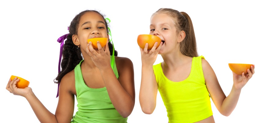 girls eating citrus