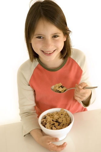 girl eating breakfast cereal